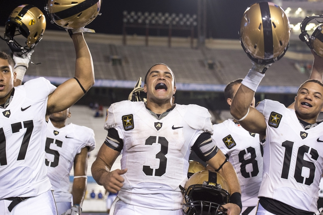 Sep 28, 2013; Dallas, TX, USA; Army Black Knights defensive back Tyler Dickson (17) and quarterback Angel Santiago (3) and quarterback Kelvin White (16) celebrate the win over the Louisiana Tech Bulldogs at the Cotton Bowl Stadium. The Black Knights defeated the Bulldogs 35-16. Mandatory Credit: Jerome Miron-USA TODAY Sports
