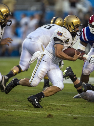 Sep 28, 2013; Dallas, TX, USA; Army Black Knights quarterback Angel Santiago (3) runs with the ball during second half against the Louisiana Tech Bulldogs at the Cotton Bowl Stadium. The Black Knights defeated the Bulldogs 35-16. Mandatory Credit: Jerome Miron-USA TODAY Sports