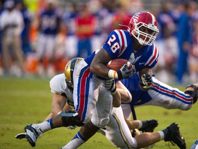 Sep 28, 2013; Dallas, TX, USA; Louisiana Tech Bulldogs running back Kenneth Dixon (28) runs for a first down against the Army Black Knights during second half at the Cotton Bowl Stadium. The Black Knights defeated the Bulldogs 35-16. Mandatory Credit: Jerome Miron-USA TODAY Sports