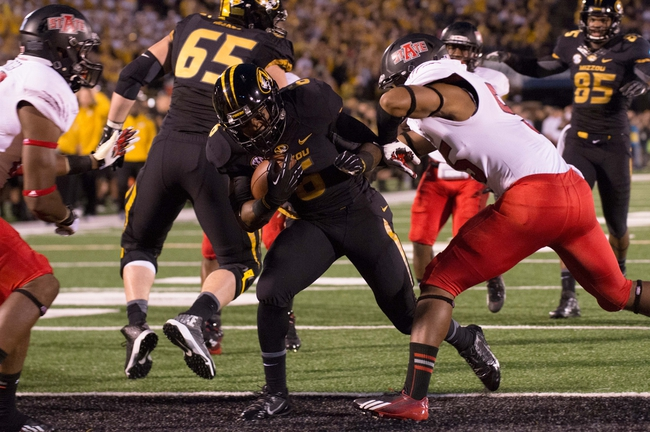 Sep 28, 2013; Columbia, MO, USA; Missouri Tigers running back Marcus Murphy (6) scores a touchdown during the first half against the Arkansas State Red Wolves  at Faurot Field. Mandatory Credit: Jasen Vinlove-USA TODAY Sports