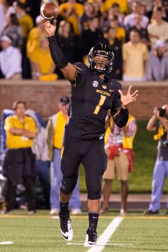 Sep 28, 2013; Columbia, MO, USA; Missouri Tigers quarterback James Franklin (1) makes a pass against the Arkansas State Red Wolves during the first half at Faurot Field. Mandatory Credit: Jasen Vinlove-USA TODAY Sports