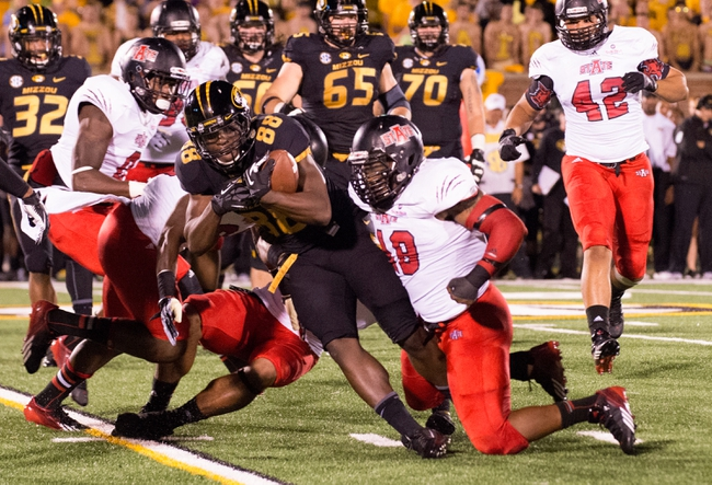 Sep 28, 2013; Columbia, MO, USA; Missouri Tigers wide receiver Jimmie Hunt (88) is tackled by Arkansas State Red Wolves defensive back Colin Janice (13) during the first half at Faurot Field. Mandatory Credit: Jasen Vinlove-USA TODAY Sports