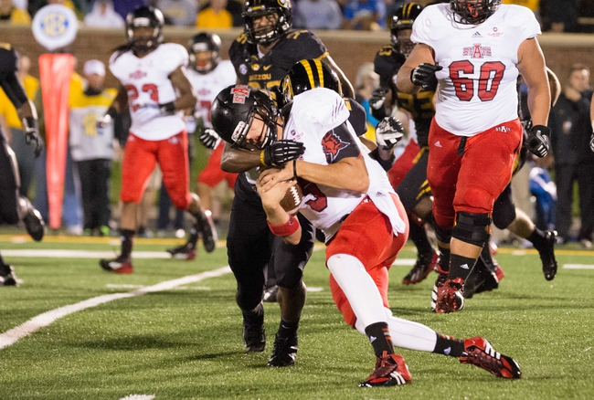 Sep 28, 2013; Columbia, MO, USA; Arkansas State Red Wolves quarterback Adam Kennedy (5) is sacked by Missouri Tigers safety Ian Simon (21) during the first half at Faurot Field. Mandatory Credit: Jasen Vinlove-USA TODAY Sports