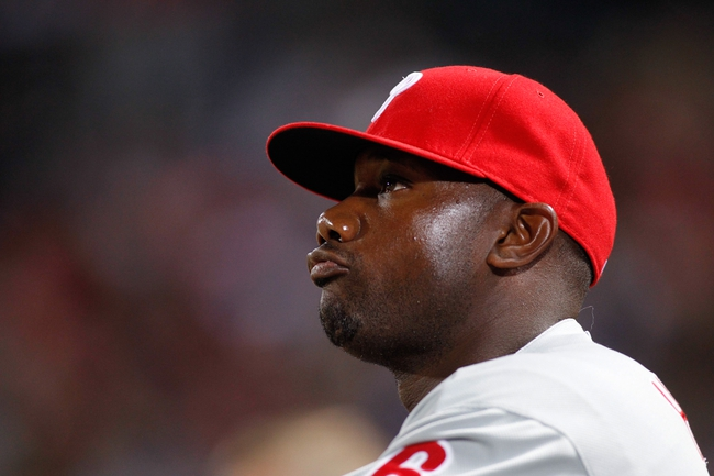 Sep 28, 2013; Atlanta, GA, USA; Philadelphia Phillies first baseman Ryan Howard (6) watches from the dugout against the Atlanta Braves in the third inning at Turner Field. Mandatory Credit: Brett Davis-USA TODAY Sports