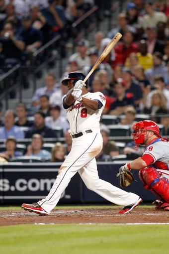 Sep 28, 2013; Atlanta, GA, USA; Atlanta Braves left fielder Justin Upton (8) hits a double against the Philadelphia Phillies in the fifth inning at Turner Field. Mandatory Credit: Brett Davis-USA TODAY Sports