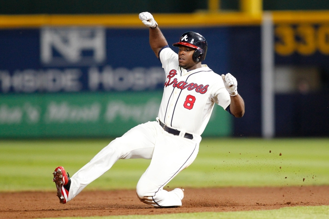 Sep 28, 2013; Atlanta, GA, USA; Atlanta Braves left fielder Justin Upton (8) slides in safely to second against the Philadelphia Phillies in the fifth inning at Turner Field. Mandatory Credit: Brett Davis-USA TODAY Sports