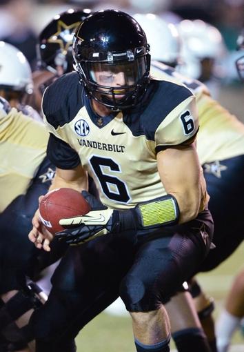 Sep 28, 2013; Nashville, TN, USA; Vanderbilt Commodores quarterback Austyn Carter-Samuels (6) drops back into the pocket after the snap against the Alabama-Birmingham Blazers during the first half at Vanderbilt Stadium. Mandatory Credit: Don McPeak-USA TODAY Sports