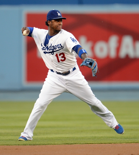 Sep 28, 2013; Los Angeles, CA, USA;   Los Angeles Dodgers shortstop Hanley Ramirez (13) makes a play in the first inning of the game against the Colorado Rockies at Dodger Stadium. Mandatory Credit: Jayne Kamin-Oncea-USA TODAY Sports
