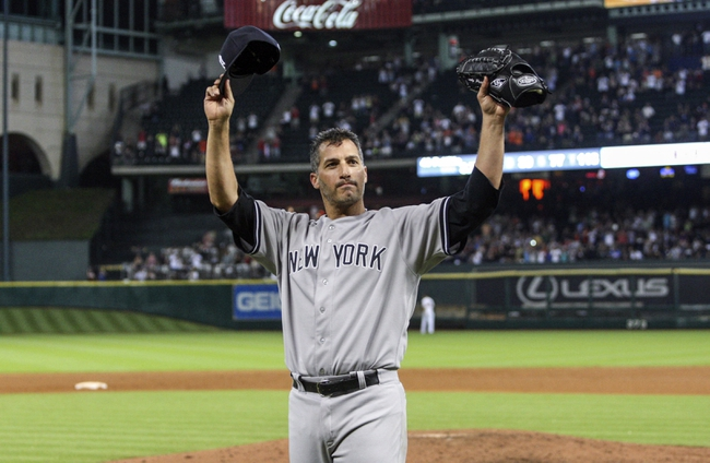 Sep 28, 2013; Houston, TX, USA; New York Yankees starting pitcher Andy Pettitte (46) waves to the crowd after pitching a complete game against the Houston Astros at Minute Maid Park. The Yankees defeated the Astros 2-1. Mandatory Credit: Troy Taormina-USA TODAY Sports