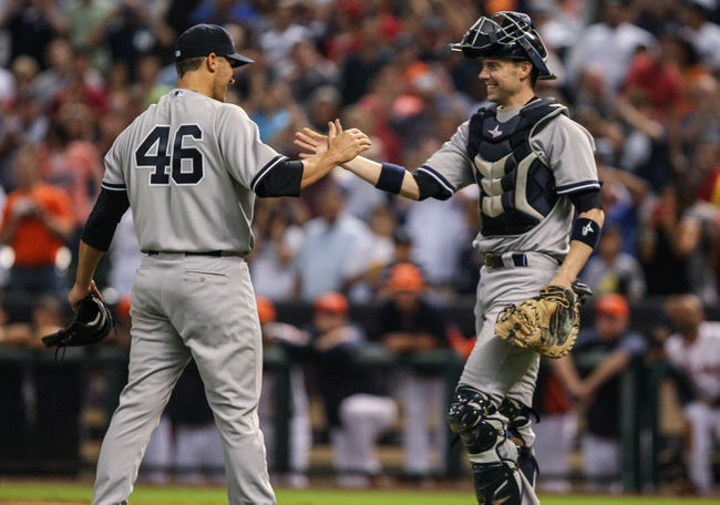 Sep 28, 2013; Houston, TX, USA; New York Yankees starting pitcher Andy Pettitte (46) and catcher Chris Stewart (19) celebrate after defeating the Houston Astros 2-1at Minute Maid Park. Mandatory Credit: Troy Taormina-USA TODAY Sports