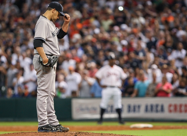 Sep 28, 2013; Houston, TX, USA; New York Yankees starting pitcher Andy Pettitte (46) pitches during the ninth inning against the Houston Astros at Minute Maid Park. Mandatory Credit: Troy Taormina-USA TODAY Sports