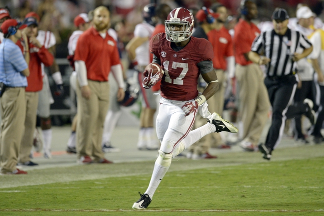 Sep 28, 2013; Tuscaloosa, AL, USA; Alabama Crimson Tide running back Kenyan Drake (17) carries the ball for a touchdown against the Mississippi Rebels during the fourth quarter at Bryant-Denny Stadium. Mandatory Credit: John David Mercer-USA TODAY Sports