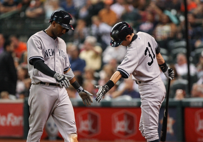 Sep 28, 2013; Houston, TX, USA; New York Yankees shortstop Eduardo Nunez (26) is congratulated by right fielder Ichiro Suzuki (31) after scoring a run during the sixth inning against the Houston Astros at Minute Maid Park. Mandatory Credit: Troy Taormina-USA TODAY Sports