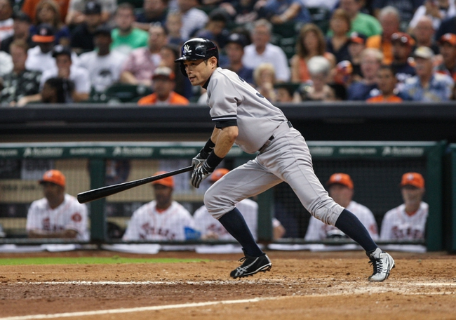 Sep 28, 2013; Houston, TX, USA; New York Yankees right fielder Ichiro Suzuki (31) gets a single during the ninth inning against the Houston Astros at Minute Maid Park. Mandatory Credit: Troy Taormina-USA TODAY Sports