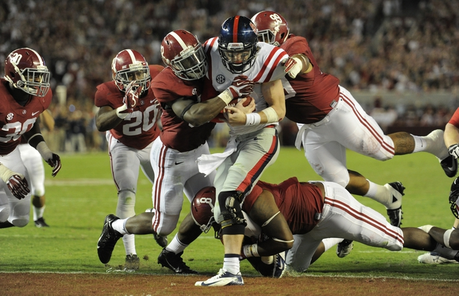 Sep 28, 2013; Tuscaloosa, AL, USA; Mississippi Rebels quarterback Bo Wallace (14) is sacked in the end zone for a safety by Alabama Crimson Tide linebacker C.J. Mosley (32) , defensive lineman Jeoffrey Pagan (8) , defensive lineman Brandon Ivory (99) during the fourth quarter at Bryant-Denny Stadium. The Alabama Crimson Tide defeated the Mississippi Rebels 25-0. Mandatory Credit: John David Mercer-USA TODAY Sports