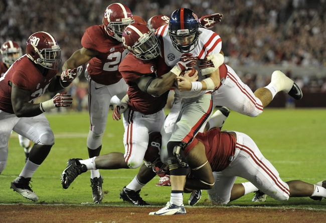 Sep 28, 2013; Tuscaloosa, AL, USA; Mississippi Rebels quarterback Bo Wallace (14) is sacked in the end zone for a safety by Alabama Crimson Tide linebacker C.J. Mosley (32) , defensive lineman Jeoffrey Pagan (8) , defensive lineman Brandon Ivory (99) , defensive back Jarrick Williams (20) and linebacker Denzel Devall (30) during the fourth quarter at Bryant-Denny Stadium. The Alabama Crimson Tide defeated the Mississippi Rebels 25-0. Mandatory Credit: John David Mercer-USA TODAY Sports