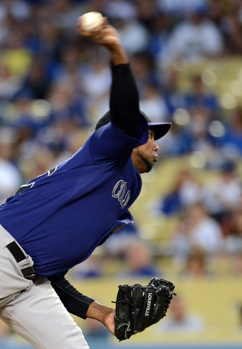Sep 28, 2013; Los Angeles, CA, USA;   Colorado Rockies starting pitcher Juan Nicasio (12) in the first inning of the game against the Los Angeles Dodgers at Dodger Stadium. Mandatory Credit: Jayne Kamin-Oncea-USA TODAY Sports