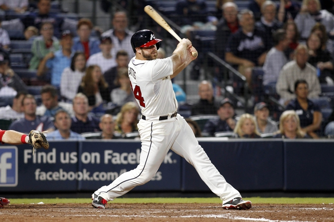 Sep 28, 2013; Atlanta, GA, USA; Atlanta Braves left fielder Evan Gattis (24) this a single against the Philadelphia Phillies in the eighth inning at Turner Field. Mandatory Credit: Brett Davis-USA TODAY Sports