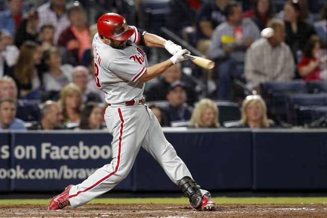 Sep 28, 2013; Atlanta, GA, USA; Philadelphia Phillies first baseman Kevin Frandsen (28) hits a single against the Atlanta Braves in the eighth inning at Turner Field. The Phillies defeated the Braves 5-4. Mandatory Credit: Brett Davis-USA TODAY Sports
