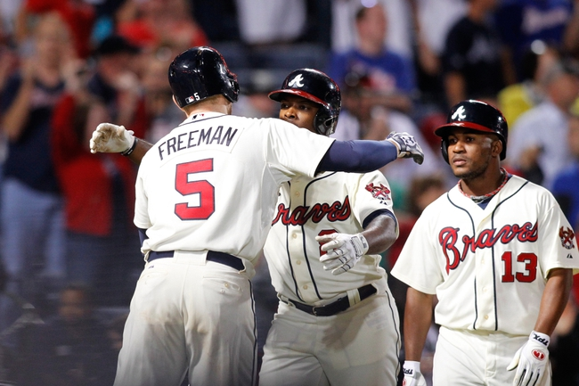 Sep 28, 2013; Atlanta, GA, USA; Atlanta Braves left fielder Justin Upton (8) is congratulated by first baseman Freddie Freeman (5) after a home run against the Philadelphia Phillies in the ninth inning at Turner Field. The Phillies defeated the Braves 5-4. Mandatory Credit: Brett Davis-USA TODAY Sports