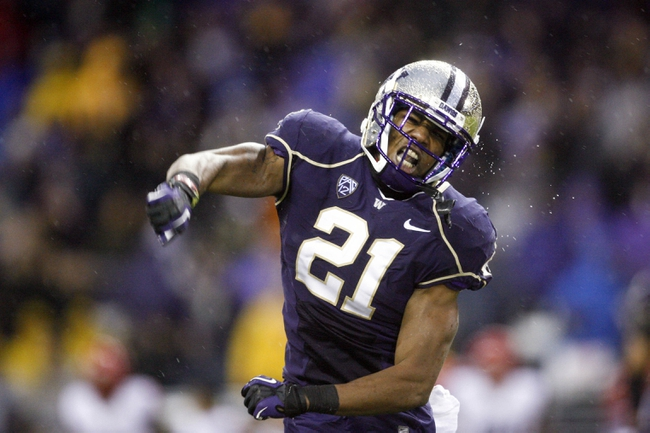 Sep 28, 2013; Seattle, WA, USA; Washington Huskies defensive back Marcus Peters (21) reacts to a fourth down stop against the Arizona Wildcats during the fourth quarter at Husky Stadium. Mandatory Credit: Joe Nicholson-USA TODAY Sports
