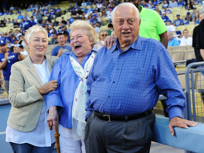 Sep 28, 2013; Los Angeles, CA, USA;   Los Angeles Dodgers Tommy Lasorda and his wife Jo and daughter Laura, watch a tribute on the video board in honor of his 86th birthday before the game against the Colorado Rockies at Dodger Stadium. Mandatory Credit: Jayne Kamin-Oncea-USA TODAY Sports