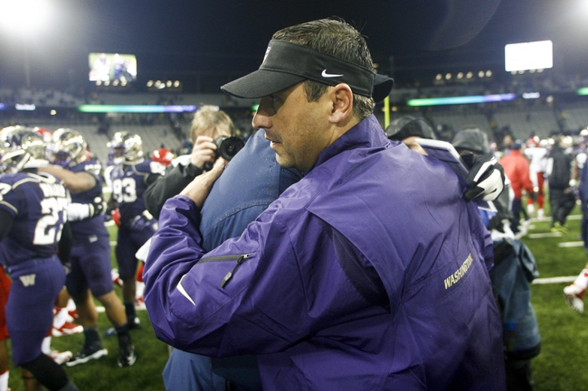 Sep 28, 2013; Seattle, WA, USA; Washington Huskies head coach Steve Sarkisian (front) and Arizona Wildcats head coach Rich Rodriguez shake hands following a 31-13 Washington victory at Husky Stadium. Mandatory Credit: Joe Nicholson-USA TODAY Sports