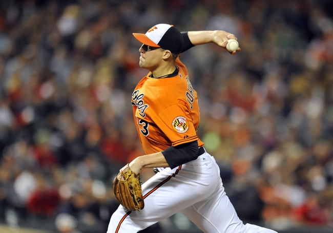 Sep 28, 2013; Baltimore, MD, USA; Baltimore Orioles pitcher Jim Johnson (43) throws in the ninth inning against the Boston Red Sox at Oriole Park at Camden Yards. The Orioles defeated the Red Sox 6-5. Mandatory Credit: Joy R. Absalon-USA TODAY Sports