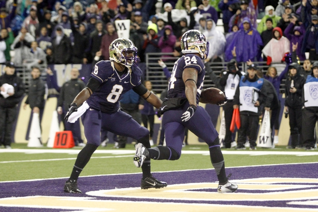 Sep 28, 2013; Seattle, WA, USA; Washington Huskies running back Jesse Callier (24) celebrates with Washington Huskies wide receiver Kevin Smith (8) after rushing for a touchdown against the Arizona Wildcats during the fourth quarter at Husky Stadium. Mandatory Credit: Joe Nicholson-USA TODAY Sports