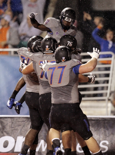 Sep 28, 2013; Boise, ID, USA; Boise State Broncos wide receiver Shane Williams-Rhodes (11) is hoisted into the air by the offensive line after scoring a touchdown during the first half against the Southern Miss Golden Eagles at Bronco Stadium. Mandatory Credit: Brian Losness-USA TODAY Sports