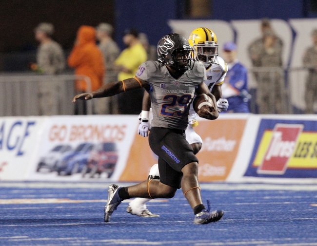 Sep 28, 2013; Boise, ID, USA; Boise State Broncos running back Aaron Baltazar (29) runs for a first down during the first half against the Southern Miss Golden Eagles at Bronco Stadium. Mandatory Credit: Brian Losness-USA TODAY Sports