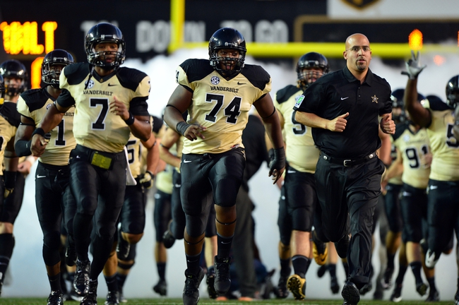 Sep 28, 2013; Nashville, TN, USA; Vanderbilt Commodores head coach James Franklin enters the field with his team before a game against the Alabama-Birmingham Blazers at Vanderbilt Stadium. The Commodores beat the Blazers 52-24. Mandatory Credit: Don McPeak-USA TODAY Sports