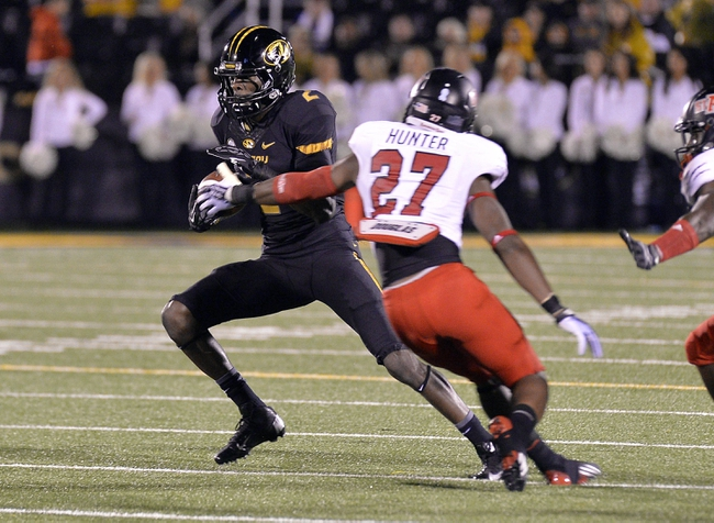 Sep 28, 2013; Columbia, MO, USA; Missouri Tigers wide receiver L'Damian Washington (2) avoids a tackle from Arkansas State Red Wolves defensive back Money Hunter (27) during the second half at Faurot Field. Mandatory Credit: Jasen Vinlove-USA TODAY Sports