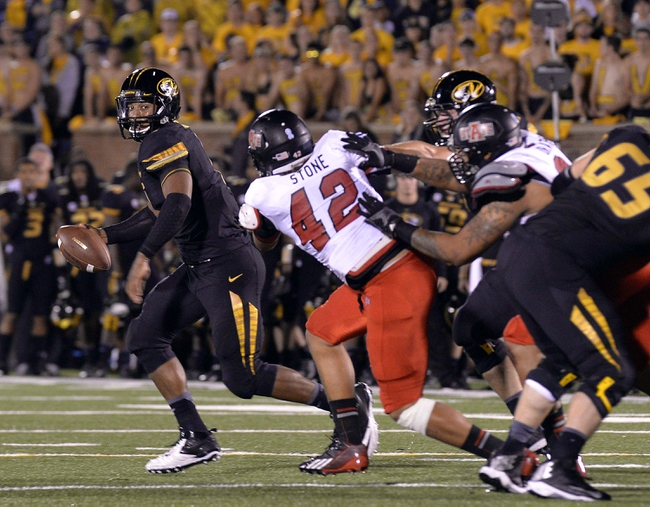 Sep 28, 2013; Columbia, MO, USA; Missouri Tigers quarterback James Franklin (1) is pressured by Arkansas State Red Wolves defensive end Chris Stone (42) during the second half of the game between the Missouri Tigers and the Arkansas State Red Wolves at Faurot Field. Mandatory Credit: Jasen Vinlove-USA TODAY Sports