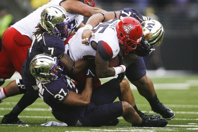Sep 28, 2013; Seattle, WA, USA; Arizona Wildcats running back Ka'Deem Carey (25) is tackled for a loss by Washington Huskies linebacker Princeton Fuimaono (37), Washington Huskies linebacker Shaq Thompson (7) Washington Huskies defensive tackle Danny Shelton (71) during the first quarter at Husky Stadium. Mandatory Credit: Joe Nicholson-USA TODAY Sports