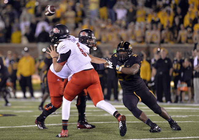 Sep 28, 2013; Columbia, MO, USA; Arkansas State Red Wolves quarterback Adam Kennedy (5) makes a pass under pressure against the Missouri Tigers during the second half at Faurot Field. Mandatory Credit: Jasen Vinlove-USA TODAY Sports