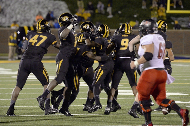 Sep 28, 2013; Columbia, MO, USA; The Missouri Tigers celebrate a turnover against the Arkansas State Red Wolves during the second half at Faurot Field. Mandatory Credit: Jasen Vinlove-USA TODAY Sports