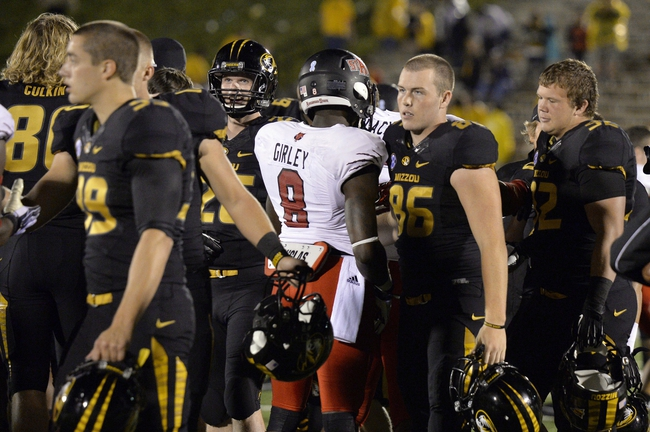 Sep 28, 2013; Columbia, MO, USA; The Missouri Tigers and Arkansas State Red Wolves congratulate each other after the game between. The Tigers defeat the Red Wolves 41-19 at Faurot Field. Mandatory Credit: Jasen Vinlove-USA TODAY Sports