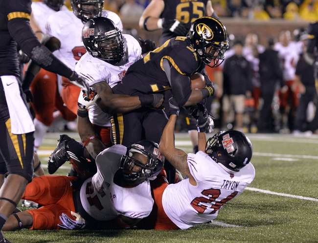 Sep 28, 2013; Columbia, MO, USA; Missouri Tigers running back Russell Hansbrough (32) is tackled by Arkansas State Red Wolves defensive back Andrew Tryon (24) during the second half at Faurot Field. Mandatory Credit: Jasen Vinlove-USA TODAY Sports
