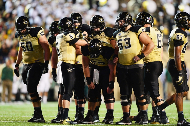 Sep 28, 2013; Nashville, TN, USA; The Vanderbilt Commodores offense huddles in a game against the Alabama-Birmingham Blazers during the second half at Vanderbilt Stadium. The Commodores beat the Blazers 52-24. Mandatory Credit: Don McPeak-USA TODAY Sports