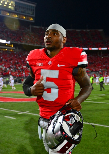 Sep 28, 2013; Columbus, OH, USA; Ohio State Buckeyes quarterback Braxton Miller (5) walks off the field after defeating the Wisconsin Badgers  31-24 at Ohio Stadium. Mandatory Credit: Andrew Weber-USA TODAY Sports
