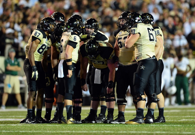 Sep 28, 2013; Nashville, TN, USA; Vanderbilt Commodores offense huddles in a game against the Alabama-Birmingham Blazers during the first half at Vanderbilt Stadium. The Commodores beat the Blazers 52-24. Mandatory Credit: Don McPeak-USA TODAY Sports