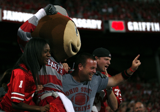 Sep 28, 2013; Columbus, OH, USA; Ohio State Buckeyes mascot Brutus celebrates with fans during the fourth quarter against the Wisconsin Badgers at Ohio Stadium. Buckeyes beat the Badgers 31-24. Mandatory Credit: Raj Mehta-USA TODAY Sports