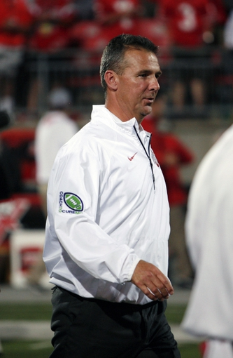 Sep 28, 2013; Columbus, OH, USA; Ohio State Buckeyes head coach Urban Meyer walks off the field after the game against the Wisconsin Badgers at Ohio Stadium. Buckeyes beat the Badgers 31-24. Mandatory Credit: Raj Mehta-USA TODAY Sports