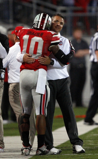 Sep 28, 2013; Columbus, OH, USA; Ohio State Buckeyes head coach Urban Meyer hugs linebacker Ryan Shazier (10) during the fourth quarter against the Wisconsin Badgers at Ohio Stadium. Buckeyes beat the Badgers 31-24. Mandatory Credit: Raj Mehta-USA TODAY Sports