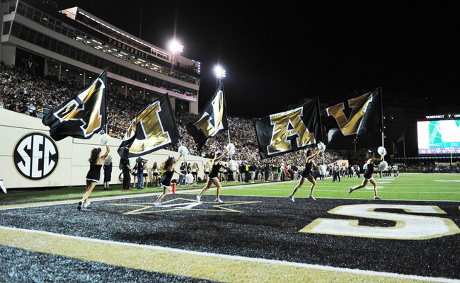 Sep 28, 2013; Nashville, TN, USA; Members of the Vanderbilt Commodores cheer leading squad perform in a game against the Alabama-Birmingham Blazers during the first half at Vanderbilt Stadium. The Commodores beat the Blazers 52-24. Mandatory Credit: Don McPeak-USA TODAY Sports