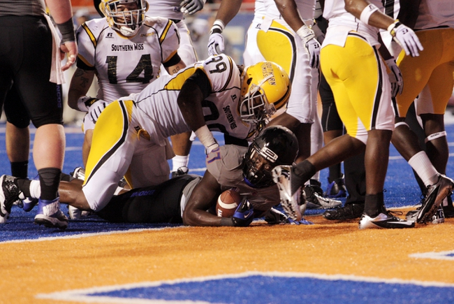 Sep 28, 2013; Boise, ID, USA; Boise State Broncos running back Jay Ajayi (27) scores a touchdown during the first half against the Southern Miss Golden Eagles at Bronco Stadium. Mandatory Credit: Brian Losness-USA TODAY Sports