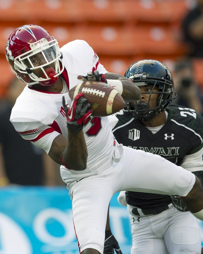 Sep 28, 2013; Honolulu, HI, USA; Fresno State wide receiver Josh Harper (3) pulls in a touchdown over Hawaii cornerback Dee Maggitt (23) during the first quarter of the NCAA college football game at Aloha Stadium. Mandatory Credit: Marco Garcia-USA TODAY Sports