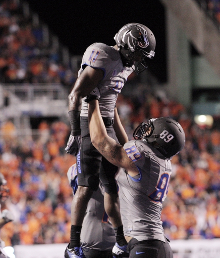 Sep 28, 2013; Boise, ID, USA; Boise State Broncos tight end Connor Peters (89) lifts wide receiver Shane Williams-Rhodes (11) in celebration after Rhodes scored his second touchdown during the first half against the Southern Miss Golden Eagles at Bronco Stadium. Mandatory Credit: Brian Losness-USA TODAY Sports