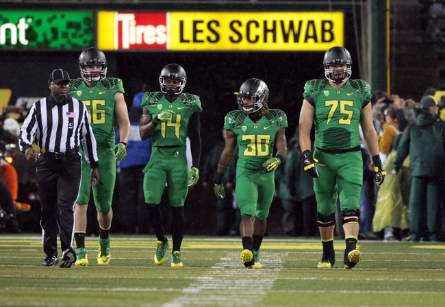 Sep 28, 2013; Eugene, OR, USA; Oregon Ducks defensive tackle Taylor Hart (66) and cornerback Ifo Ekpre-Olomu (14) and running back Ayele Forde (30) and offensive linesman Jake Fisher (75) at the beginning of the California Golden Bears at Autzen Stadium. Mandatory Credit: Scott Olmos-USA TODAY Sports